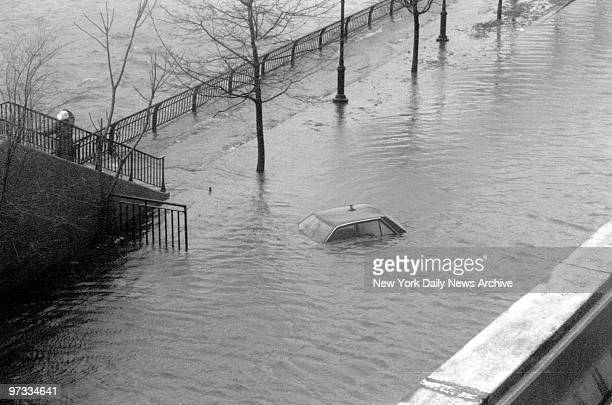 Only car roof is visible in flooded northbound lane of the FDR Drive at 80th St