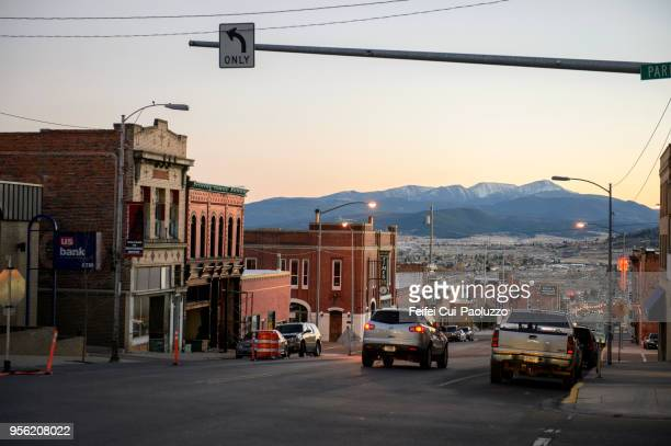 only left turn sign at downtown street of butte, montana, usa - montana stock pictures, royalty-free photos & images