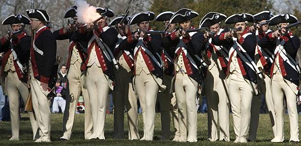 Only one member of an Old Guard platoon's musket fires during a Revolutionary War battle demonstration at the Mount Vernon Estate and Gardens on...