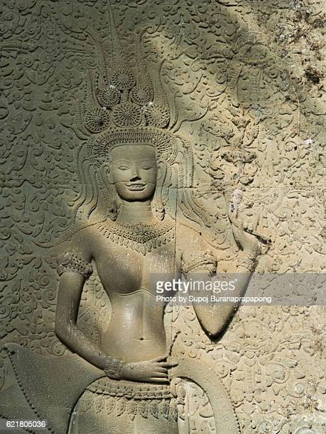 Only one smilely apsara  sculpture from 1800+ apsara at Angkor wat , siem reap , cambodia