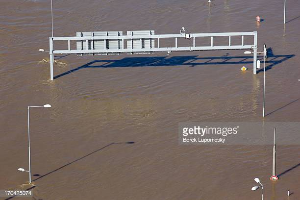Only road signs are to be seen of main north-bound four lane road submerged in Elbe waters during June 2013 floods in Usti nad Labem, Czech Republic.