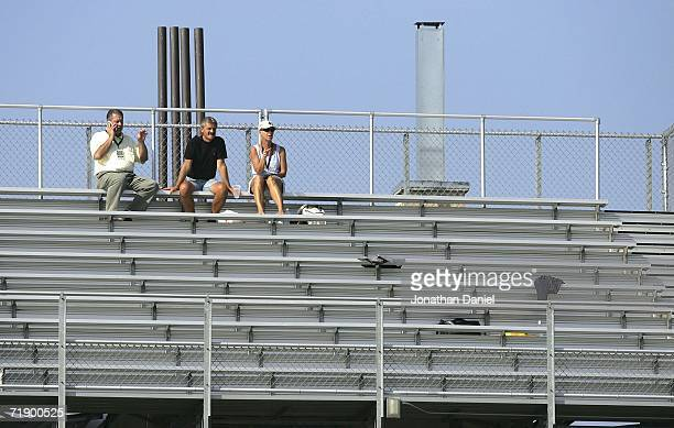 Only three fans watch from a roof top deck on Waveland Avenue across from Wrigley Field as the Chicago Cubs take on the Cincinnati Reds on September...