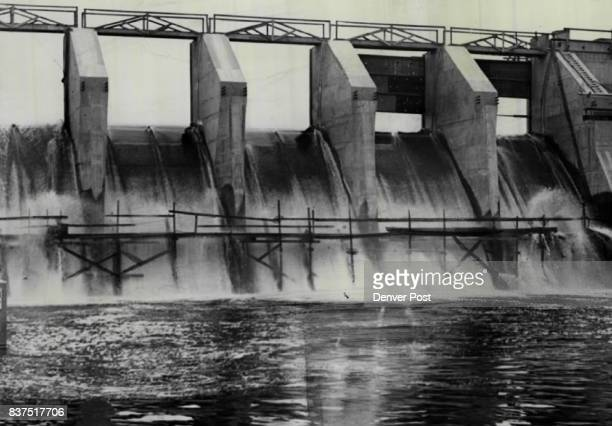 Only two of five giant flood gates had been installed in the new Olympus dam at Estes Park Colo when a strike of iron workers closed down virtually...
