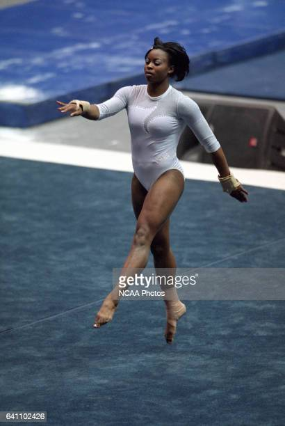 Onnie Willis of the University of California Los Angeles competes in the floor exercise during the Super Six Team Finals of the NCAA Women's Division...