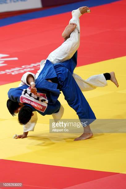 Ono Shohei of Japan battles An Changrim of South Korea during the Men's 73 kg Judo gold medal match at the JCCPlenary Hall on day twelve of the 18th...