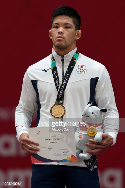 Ono Shohei of Japan poses with his gold medal after he defeated An Changrim of South Korea during the Men's 73 kg Judo gold medal match at the...