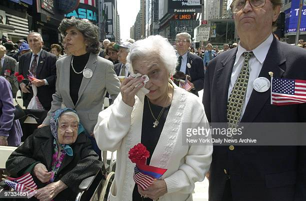 Onorik Eninian wipes tears from her eyes as she's joined by Papken Kadekuian and Lucy Derderian in Times Square where a memorial was held for...