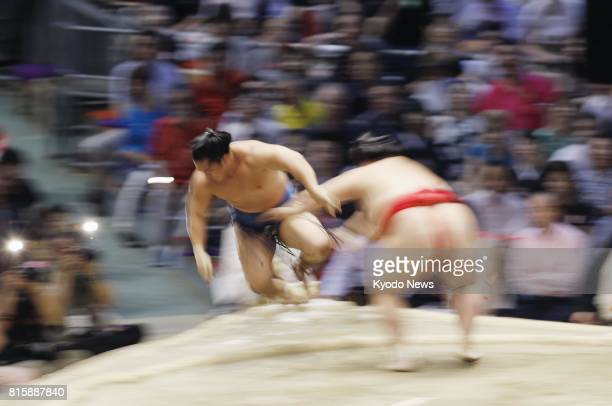 Onosho pushes Ishiura out and off the dohyo ring during the Nagoya Grand Sumo Tournament in Nagoya central Japan on July 13 2017 ==Kyodo