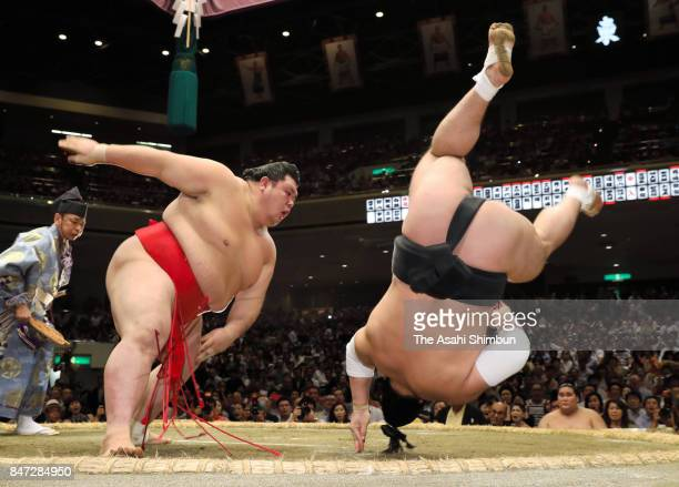 Onosho throws Mongolian yokozuna Harumafuji to win during day five of the Grand Sumo Autumn Tournament at Ryogoku Kokugikan on September 14 2017 in...