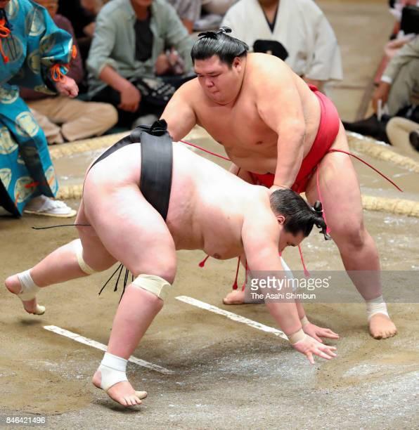 Onosho throws Monogolian ozeki Terunofuji to win during day four of the Grand Sumo Autumn Tournament at Ryogoku Kokugikan on September 13 2017 in...