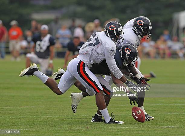 Onrea Jones of the Chicago Bears drops a pass under pressure from Anthony Walters and Zack Bowman during a summer training camp practice at Olivet...