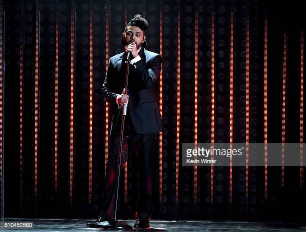 onRecording artist The Weeknd performs stage during The 58th GRAMMY Awards at Staples Center on February 15 2016 in Los Angeles California