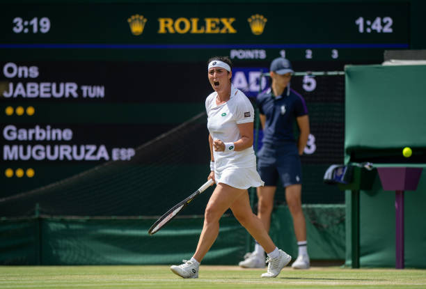 Ons Jabeur of Tunisia celebrates a point during their Ladies Singles Third Round match against Garbine Muguruza of Spain during Day Five of The...