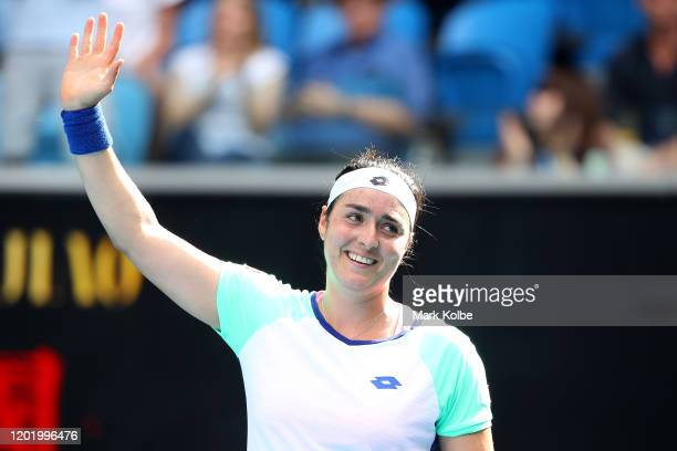 Ons Jabeur of Tunisia celebrates after winning match point after her Women's Singles fourth round match against Qiang Wang of China on day seven of...