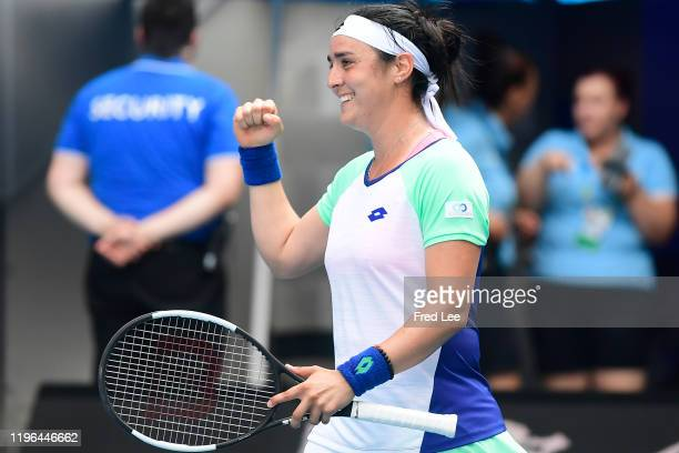 Ons Jabeur of Tunisia celebrates after winning match point during her Women's Singles fourth round match against Qiang Wang of China on day seven of...
