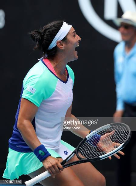 Ons Jabeur of Tunisia celebrates after winning match point during her Women's Singles third round match against Caroline Wozniacki of Denmark on day...
