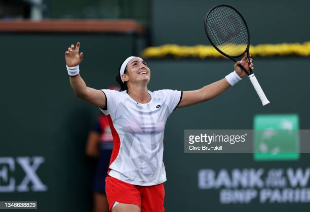 Ons Jabeur of Tunisia celebrates match point against Anett Kontaveit of Estonia during their quarterfinal match on Day 11 of the BNP Paribas Open at...