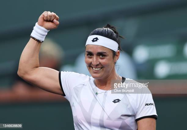 Ons Jabeur of Tunisia celebrates to the crowd after her straight sets victory against Anett Kontaveit of Estonia during their quarterfinal match on...