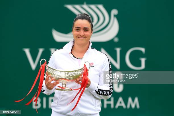 Ons Jabeur of Tunisia celebrates with the Maud Watson Trophy after victory against Daria Kasatkina of Russia in the Womens Singles Final during the...