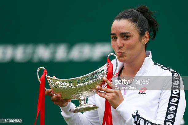 Ons Jabeur of Tunisia celebrates with the Maud Watson Trophy after victory against Daria Kasatkina of Russia in the Womens Singles Final of the...