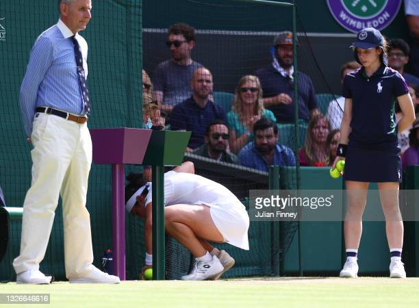 Ons Jabeur of Tunisia is ill prior to her match point against Garbine Muguruza of Spain during their Ladies Singles Third Round match during Day Five...
