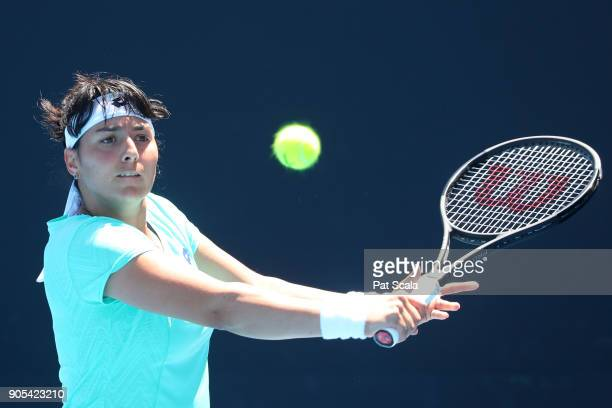 Ons Jabeur of Tunisia plays a backhand in her first round match against Elena Vesnina of Russia on day two of the 2018 Australian Open at Melbourne...
