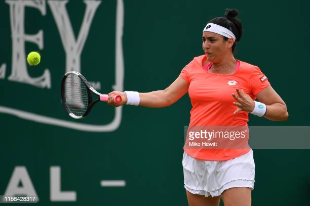 Ons Jabeur of Tunisia plays a forehand during her victory over Johanna Konta of Great Britain on day 3 of the Nature Valley International at...
