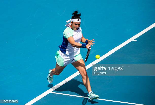 Ons Jabeur of Tunisia plays a forehand in her first round match against Johanna Konta of Great Britain on day two of the 2020 Australian Open at...