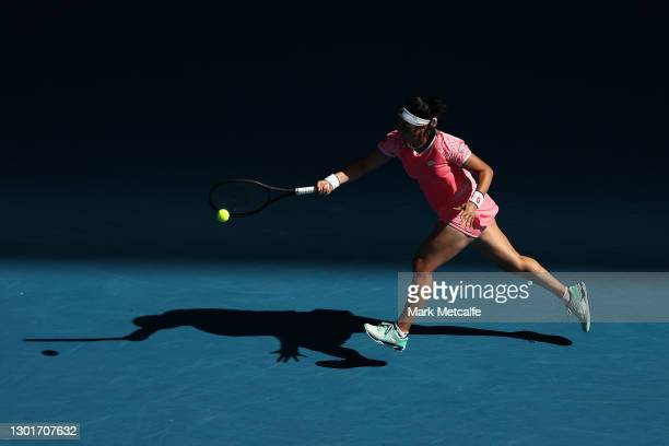 Ons Jabeur of Tunisia plays a forehand in her Women's Singles third round match against Naomi Osaka of Japan during day five of the 2021 Australian...