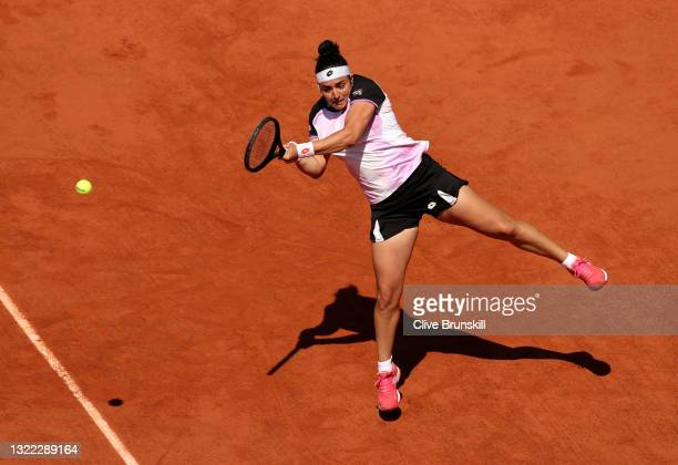 Ons Jabeur of Tunisia plays a forehand in their ladies singles fourth round match against Coco Gauff of The United States during day nine of the 2021...