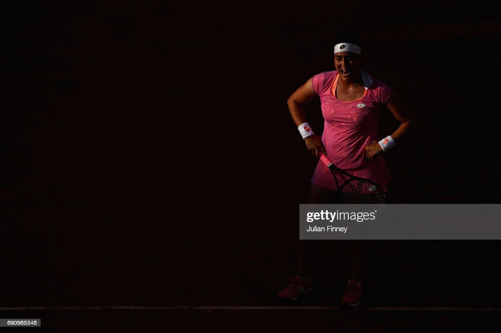 Ons Jabeur of Tunisia reacts during the ladies singles second round match against Dominika Cibulkoba of Slovakia on day four of the 2017 French Open at Roland Garros on May 31, 2017 in Paris, France.
