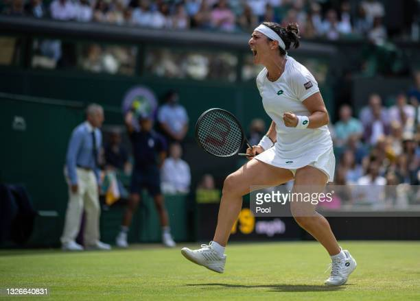 Ons Jabeur of Tunisia reacts during their Ladies Singles Third Round match against Garbine Muguruza of Spain during Day Five of The Championships -...