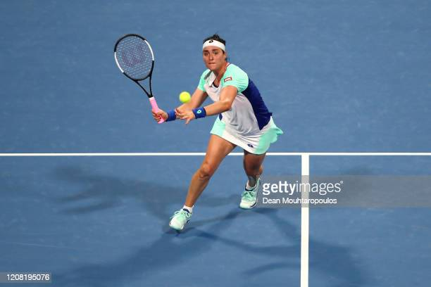 Ons Jabeur of Tunisia returns a forehand against Katerina Siniakova of Czech Republic during Day 1 of the WTA Qatar Total Open 2020 at Khalifa...