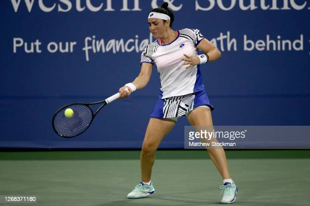 Ons Jabeur of Tunisia returns a shot to Madison Keys during the Western & Southern Open at the USTA Billie Jean King National Tennis Center on August...
