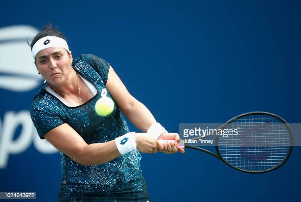 Ons Jabeur of Tunisia returns the ball during her ladies singles first round match against Ashley Barty of Australia on Day One of the 2018 US Open...