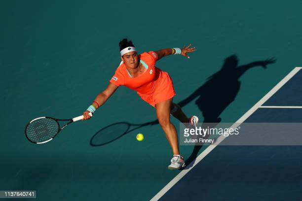 Ons Jabeur of Tunisia stretches for a forehand against Sloane Stephens of USA during day five of the Miami Open Tennis on March 22, 2019 in Miami...