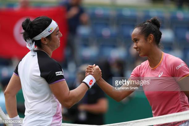 Ons Jabeur of Tunisia with Leylah Fernandez of Canada after their match during the Viking Classic Birmingham at Edgbaston Priory Club on June 17,...