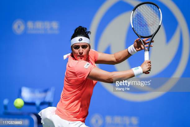 Ons Jabeur of Turkey returns a shot during the match against Donna Vekic of Croatia on Day 2 of 2019 Dongfeng Motor Wuhan Open at Optics Valley...