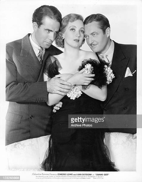 Onslow Stevens and Edmund Lowe both embrace Ann Sothern in a scene from the film 'Grand Exit' 1935