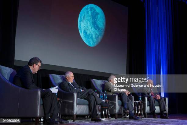 Onstage at the Museum of Science and Industry from left American author Robert Kurson interviews astronauts William Anders James Lovell and Frank...