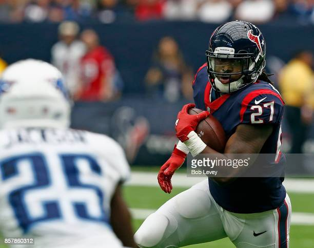 Onta Foreman of the Houston Texans keeps his eyes on Adoree' Jackson of the Tennessee Titans as he rushes at NRG Stadium on October 1 2017 in Houston...