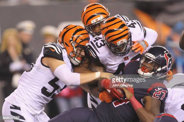 Onta Foreman of the Houston Texans runs the football upfield against Nick Vigil and George Iloka of the Cincinnati Bengals during their game at Paul...