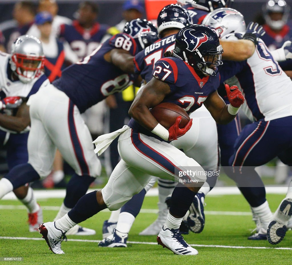 D'Onta Foreman #27 of the Houston Texans runs with the ball in the second half against the New England Patriots at NRG Stadium on August 19, 2017 in Houston, Texas. Houston won 27-23.