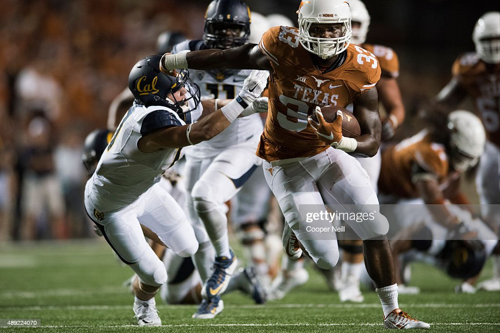 D'Onta Foreman #33 of the Texas Longhorns breaks a tackle against the California Golden Bears during the fourth quarter on September 19, 2015 at Darrell K Royal-Texas Memorial Stadium in Austin, Texas.