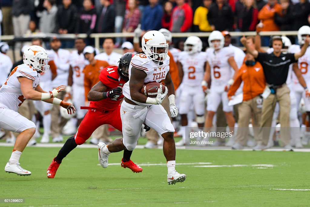D'Onta Foreman #33 of the Texas Longhorns breaks away for a touchdown during the game against the Texas Tech Red Raiders on November 5, 2016 at AT&T Jones Stadium in Lubbock, Texas. Texas defeated Texas Tech 45-37.