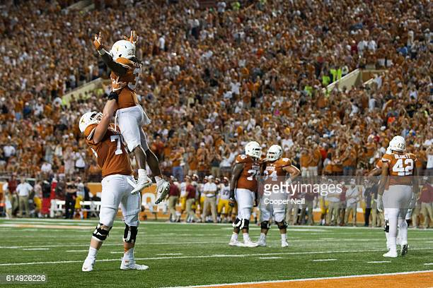 Onta Foreman of the Texas Longhorns celebrates after an 18 yard touchdown run against the Iowa State Cyclones during the second half on October 15...