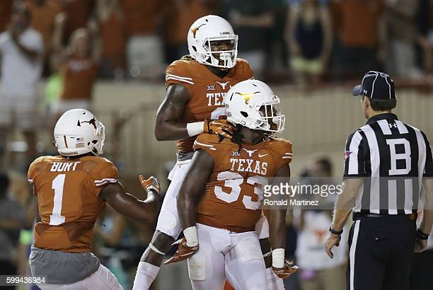 Onta Foreman of the Texas Longhorns celebrates with teammates after scoring a 19-yard rushing touchdown during the fourth quarter against the Notre...