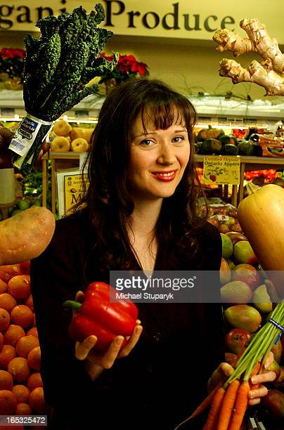 TORONTO Ontario Julie Daniluk nutritionist at The Big Carrot 'juggles' organic produce with the help of several unseen hands