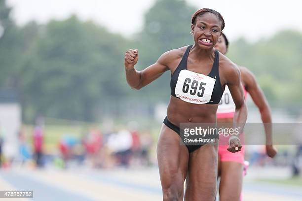 WINDSOR Ontario JUNE 13 Crystal Emmanuel centre wins the 100 metres final at The Ontario Provincial Track and Field Championships at the University...