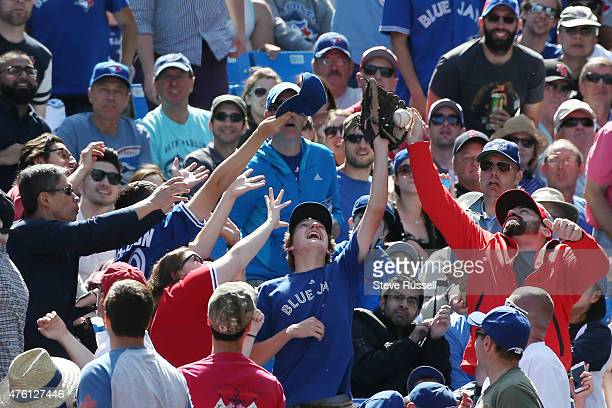 TORONTO Ontario JUNE 6 A fan narrowly misses a foul ball as the Toronto Blue Jays beat the Houston Astros 72 in an afternoon game at Rogers Centre in...